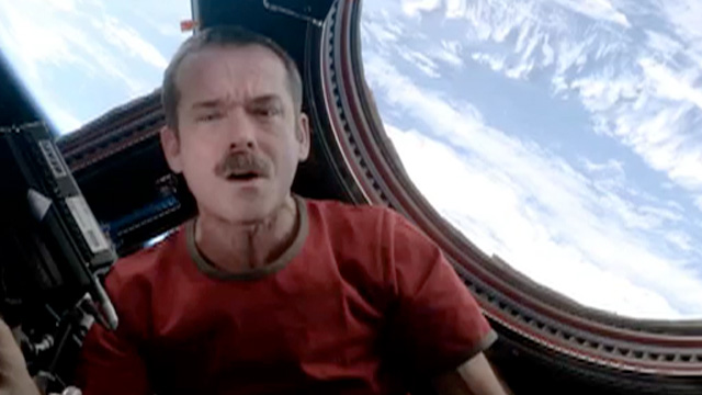International Space Station Commander, Chris Hadfield, performs a revised version of David Bowies Space Oddity.